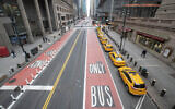 Yellow cabs line an empty 42nd St. waiting for fares outside Grand Central Terminal, in New York, March 25, 2020. (Mary Altaffer/AP)