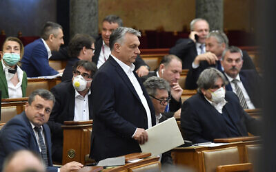 Hungarian Prime Minister Viktor Orban arrives for the plenary session of the Parliament in Budapest, Hungary, on March 30, 2020. (Zoltan Mathe/MTI via AP)