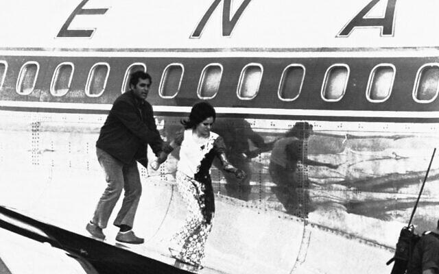 An Israeli grabs the arm of Theresa Khalsa at Lod International Airport in Tel Aviv, Israel on May 9, 1972. (AP Photo)