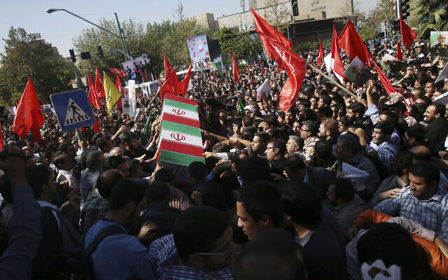 Illustrative: Iranian mourners carry the flag-draped coffin of Revolutionary Guard Gen. Hossein Hamedani during his funeral ceremony in Tehran, Iran, October 11, 2015. Hamedani, a senior commander of the Guard, was killed by Islamic State extremists near the Syrian city of Aleppo, according to a state TV report. (AP Photo/Vahid Salemi)