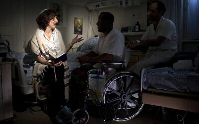 Illustrative: In this photo taken Thursday, June 20, 2013, Israeli Rabbi Miriam Berkowitz, left, of the Kashuvot organization for pastoral care, posed for a photo with a patient and nurse  at a hospital in Jerusalem. (AP Photo/Sebastian Scheiner)