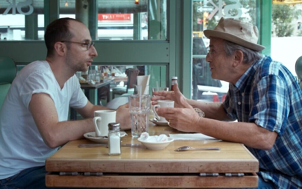 Dov Tiefenbach as Mr. Harchol and Tibor Feldman as Daddy in this still from 'About a teacher.' (Courtesy Hanan Harchol Productions)