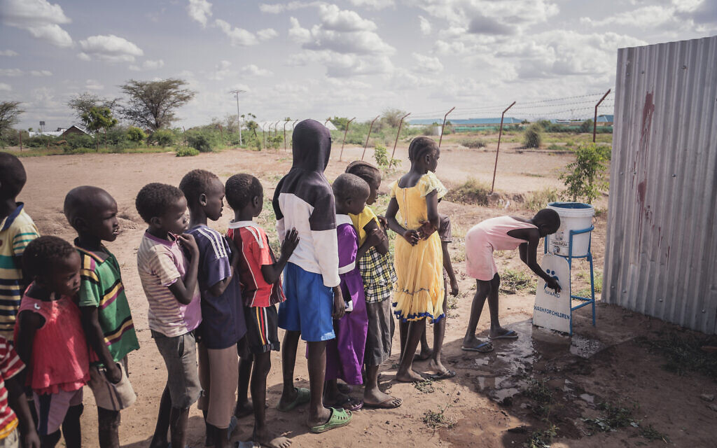 Children using the safe water facility at IsraAID space in Kakuma Refugee Camp, Kenya. (Lior Sperandeo/IsraAID)