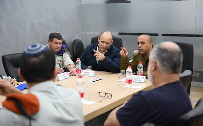 Defense Minister Naftali Bennett visits an IDF Home Front Command exercise simulating the spread of the coronavirus on March 8, 2020. (Defense Ministry)