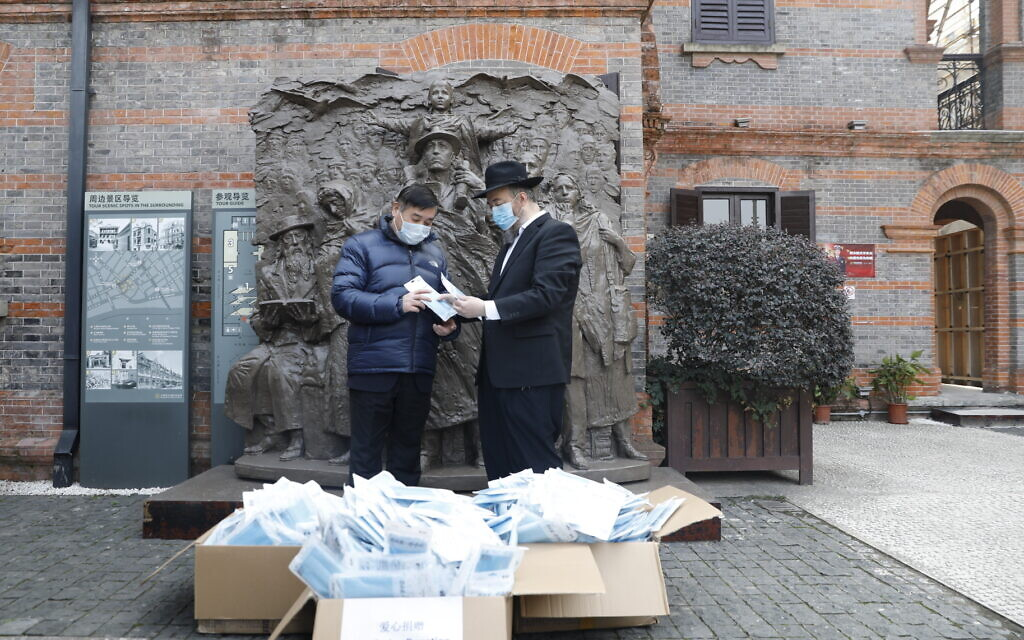Rabbi Shalom Greenberg delivers much needed face masks to Hongkou residents after a ceremony at the WWII memorial in Shanghai. (Courtesy Chabad Shanghai)
