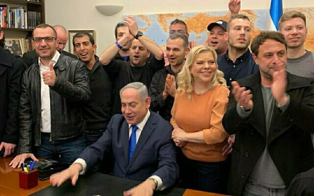 Prime Minister Benjamin Netanyahu celebrates in his Jerusalem office with his family and staff, after exit polls come out on March 2, 2020. (Twitter)