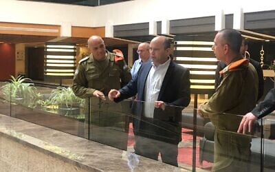 Defense Minister Naftali Bennett inspects the Dan Hotel in Tel Aviv, which was converted into a quarantine facility for carriers of the coronavirus on March 16, 2020. (Naftali Bennett's Twitter account)