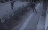 Screen capture from video showing people running for cover as eggplants rain from the sky in a prank clip made in Iran. (YouTube)