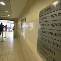 People outside the unemployment bureau in Jerusalem. (Yossi Zamir/Flash90)