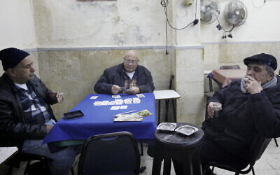 Illustrative: Elderly Israelis play cards at a coffeeshop in the Mahane Yehuda market in Jerusalem, January 10, 2012. (Miriam Alster/FLASH90/File)