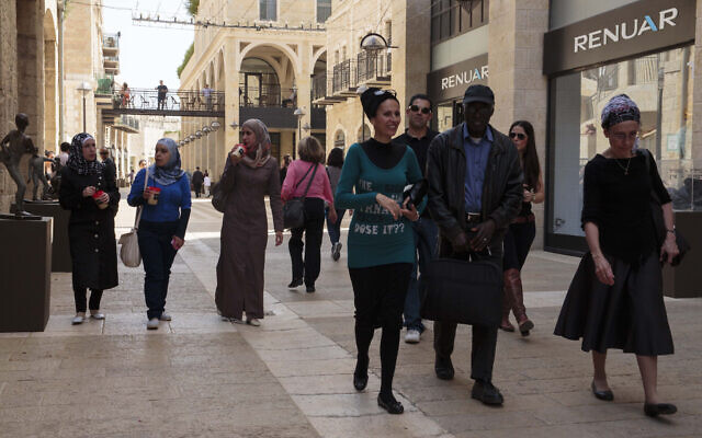 People stroll through the Mamilla Mall in Jerusalem on March 13, 2013. (Sarah Schuman/FLASH90)