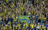 ILLUSTRATIVE -- Maccabi Tel Aviv fans during the UEFA Champions League playoff round second leg soccer match between Switzerland's FC Basel 1893 and Maccabi Tel Aviv at Bloomfield Stadium in Tel Aviv on August 25, 2015 (Yonatan Sindel/Flash90)