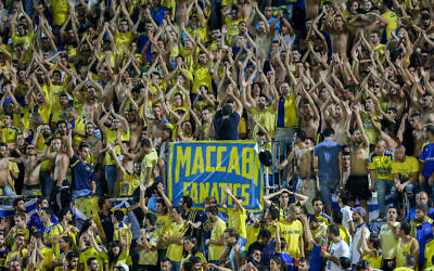Illustrative: Maccabi Tel Aviv fans during the UEFA Champions League playoff round second leg soccer match between Switzerland's FC Basel 1893 and Maccabi Tel Aviv at Bloomfield Stadium in Tel Aviv on August 25, 2015 (Yonatan Sindel/Flash90)