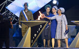Bat-Galim Shaer (L), Racheli Frenkel (C), and Iris Ifrach (R), light a torch during the main rehearsal of the 71st anniversary Independence Day ceremony, held at Mount Herzl, Jerusalem, on April 6, 2019.(Hadas Parush/Flash90)