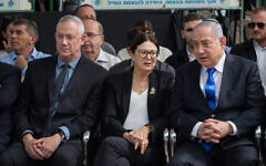 Prime Minister Benjamin Netanyahu (right), Blue and White leader Benny Gantz and Chief Justice of the Supreme Court Esther Hayut at the memorial ceremony for the late President Shimon Peres, at the Mount Herzl cemetery in Jerusalem, on September 19, 2019. (Yonatan Sindel/Flash90)