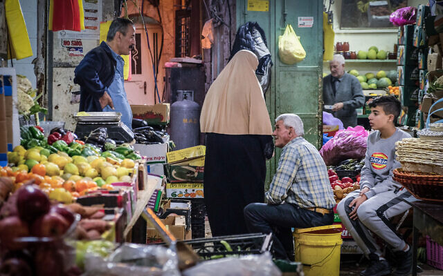 Palestinians shopping in the market in Jerusalem's Old City on November 22, 2019. (Sara Klatt/Flash90)