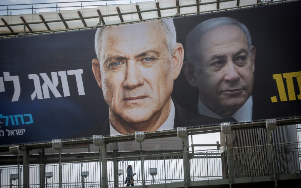 An election poster hung by the Blue and White party shows their candidate Benny Gantz and Likud's Benjamin Netanyahu on February 18, 2020. (Miriam Alster/Flash90)
