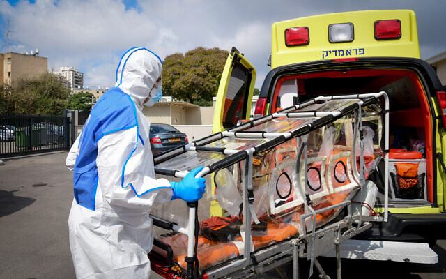A Magen David Adom paramedic wearing protective gear as a preventive measure against the coronavirus, outside a special emergency call center in Kiryat Ono, February 26, 2020. (Flash90)