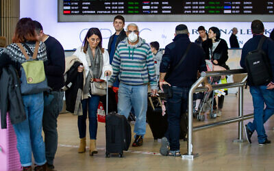 ILLUSTRATIVE -- People wearing face masks for fear of the coronavirus at the Ben Gurion International Airport on February 27, 2020 (Flash90)