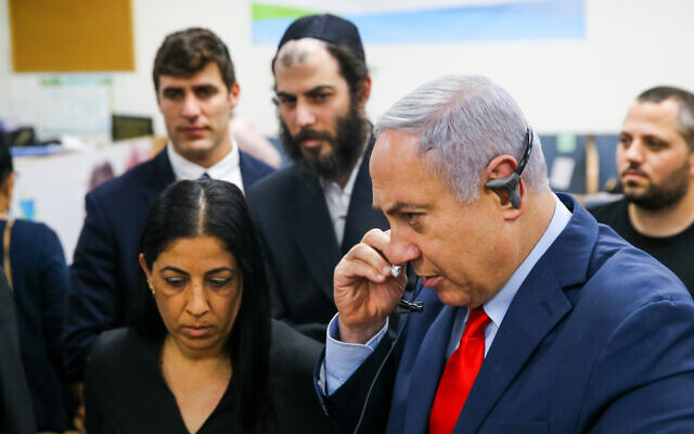 Prime Minister Benjamin Netanyahu visits at Ministry of Health Call Center in Kiryat Malachi on March 1, 2020. (Flash90)