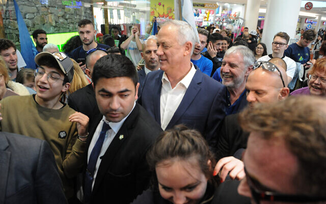 Blue and White party chairman Benny Gantz campaigns at the Grand Canyon Mall in Haifa on election day, March 2, 2020. (Flash90)