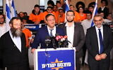 Otzma Yehudit chairman Itamar Ben Gvir (second from L) speaks to the media at the party headquarters on elections night in Jerusalem, on March 2, 2020. (Mendy Hechtman/Flash90)