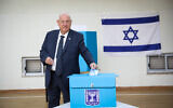President Reuven Rivlin casts his ballot at a voting station in Jerusalem, during the Knesset Elections, on March 2, 2020 (Olivier Fitoussi/Flash90)