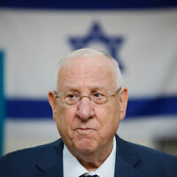 President Reuven Rivlin casts his ballot at a voting station in Jerusalem, during Knesset elections on March 2, 2020. (Olivier Fitoussi/ Flash90)