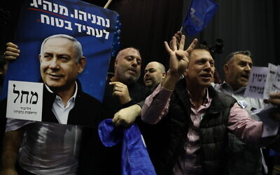 Likud supporters react to the results of the exit polls at the Likud headquarters on elections night in Tel Aviv, on March 2, 2020.  (Olivier Fitoussi/Flash90)
