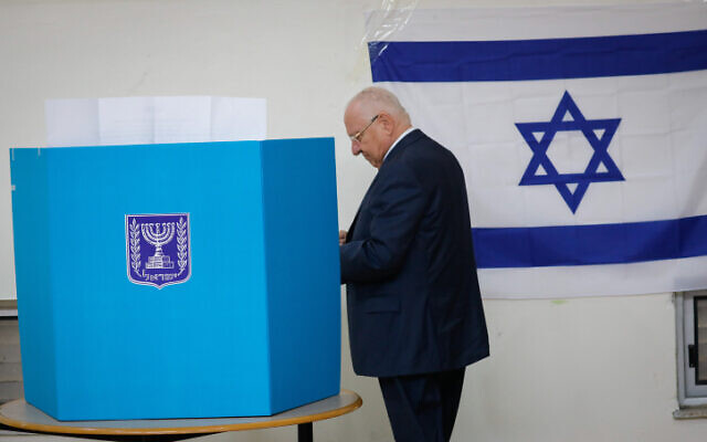 President Reuven Rivlin casts his ballot at a voting station in Jerusalem, during the Knesset Elections, on March 2, 2020. (Olivier Fitoussi/Flash90)