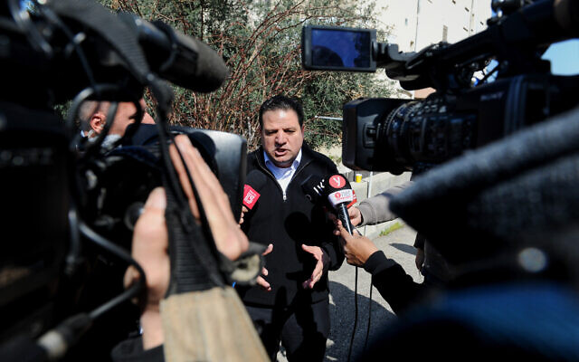 Head of the Joint List party Ayman Odeh speaks to the media outside his home in Haifa, March 3, 2020 (Meir Vaknin/Flash90)