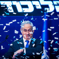 Prime Minister Benjamin Netanyahu and his wife Sara addresses their supporters on the night of the Israeli elections, at the party headquarters in Tel Aviv, on March 3, 2020. (Olivier Fitoussi/Flash90)