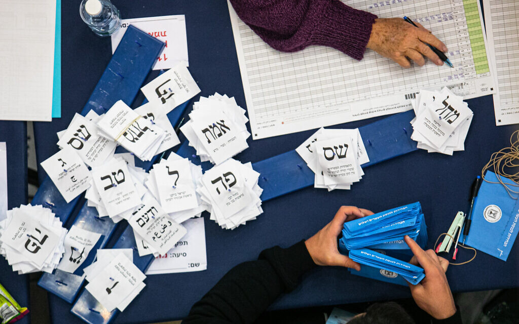 Officials count vote ballots from the elections at the Knesset in Jerusalem, March 4, 2020. (Olivier Fitoussi/Flash90)