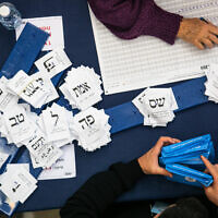 Officials count ballots from the elections at the Knesset in Jerusalem, March 4, 2020. (Olivier Fitoussi/Flash90)