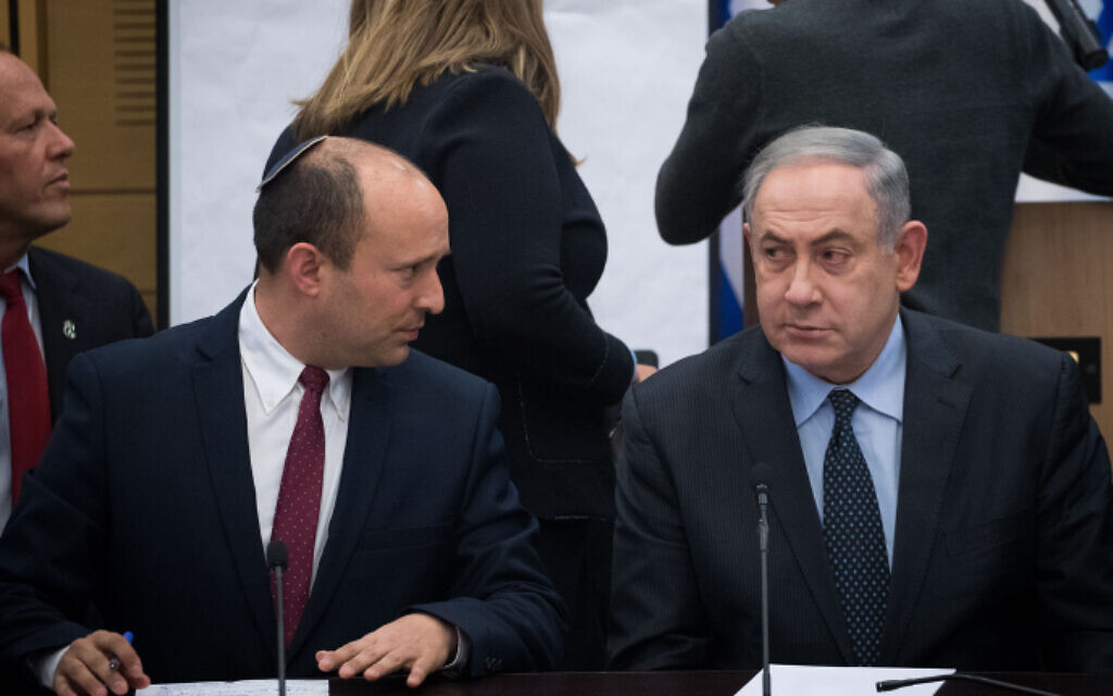 Defense Minister Naftali Bennett of Yamina, left, and Prime Minister Benjamin Netanyahu during a meeting of right-wing parties, March 4, 2020. (Yonatan Sindel/Flash90)