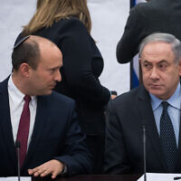Then-defense minister Naftali Bennett of Yamina, left, and Prime Minister Benjamin Netanyahu during a meeting of right-wing parties, on March 4, 2020. (Yonatan Sindel/Flash90)