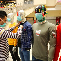Mannequins with face masks displayed outside a clothing shop, in Rafah, in the southern Gaza Strip, on March 8, 2020, as part of an effort by a Palestinian merchant to spread awareness about the COVID-19 coronavirus disease. (Abed Rahim Khatib/Flash90)