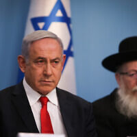 Prime Minister Benjamin Netanyahu, left, and then Health Minister Yaakov Litzman hold a press conference about the coronavirus, at the Prime Minister's Office in Jerusalem on March 8, 2020. (Yonatan Sindel/Flash90)