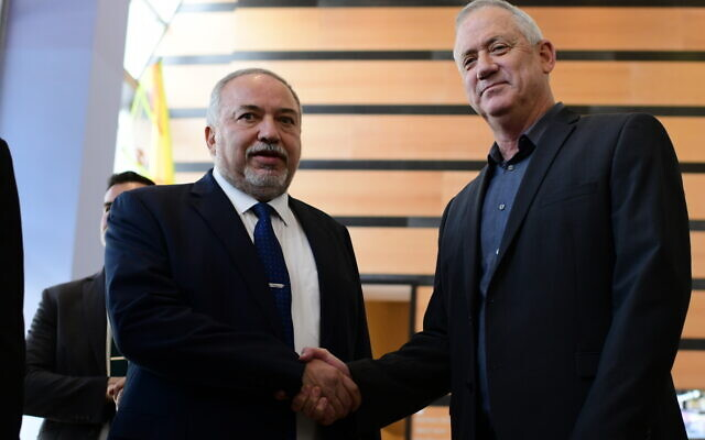 Head of the Blue and White party Benny Gantz (R) and Yisrael Beytenu leader Avigdor Liberman speak to the press after their meeting in Ramat Gan on March 9, 2020. (Tomer Neuberg/Flash90)