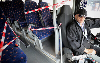 The front seats of a Jerusalem public bus are blocked off on March 10, 2020, as part of preventive measures amid fears over the spread of a new coronavirus.  (Olivier Fitoussi/Flash90)