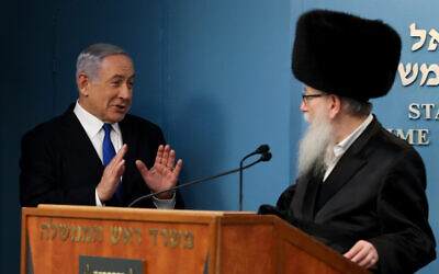Prime Minister Benjamin Netanyahu (left) with then-health minister Yaakov Litzman, in Jerusalem, on March 11, 2020. (Flash90)