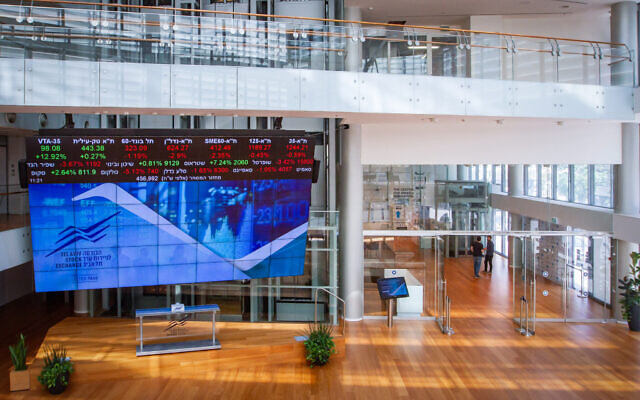 A stock market ticker screen in the lobby of the Tel Aviv Stock Exchange, in the center of Tel Aviv, March 15, 2020. (Flash90)