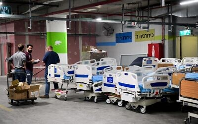 Illustrative: Workers prepare new wards for coronavirus patients at Sheba Hospital in Tel Hashomer on March 17, 2020. (Flash90)