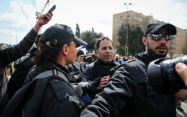 "Protesters scuffle with police during a demonstration ""to save Israel's democracy"" following far-reaching government actions against the coronavirus, outside the Knesset in Jerusalem, March 19, 2019. (Yonatan Sindel/Flash90)"