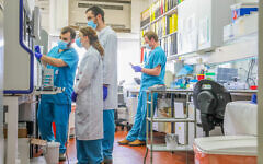 Technicians carry out a diagnostic test for coronavirus in a lab at Rambam Hospital in Haifa, on March 30, 2020. (Yossi Aloni/Flash90)