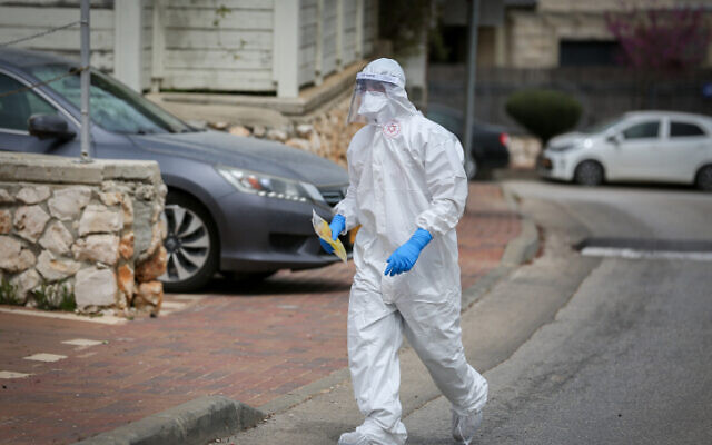 A Magen David Adom worker wears protective clothing in the northern Israeli city of Safed on March 31, 2020. (David Cohen/Flash90)