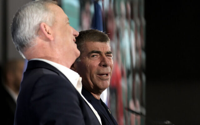 Benny Gantz (L) and Gabi Ashkenazi at a Blue and White campaign event in Kfar Saba on February 12, 2020. (Gili Yaari/ Flash90)