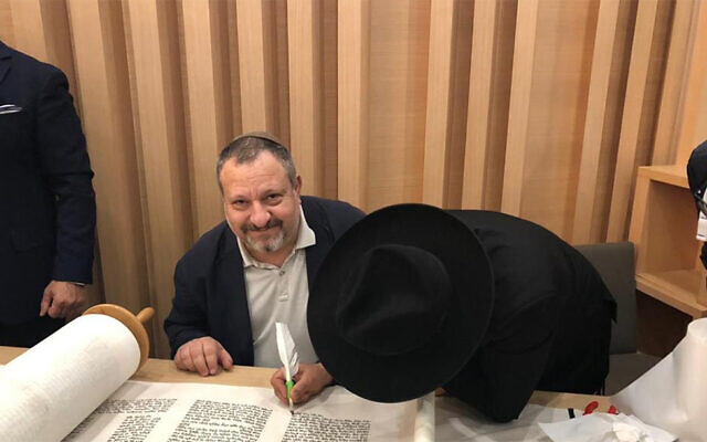 Giorgio Sinigaglia attending the writing of a Torah scroll in Milan, Italy. (Courtesy of the Jewish Community of Milan)