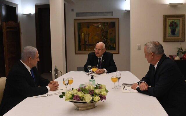 Benjamin Netanyahu, left, Reuven Rivlin, center, and Benny Gantz, meeting in Jerusalem on March 15, 2020. (Kobi Gideon/GPO)