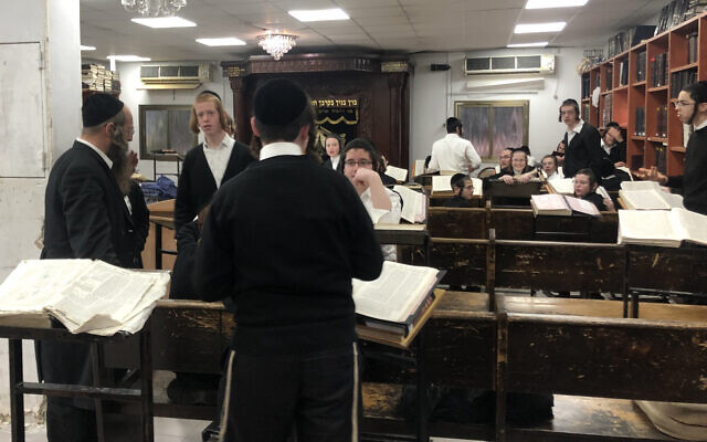 Young men study in a yeshiva open in violation of Health Ministry guidelines. March 18, 2020. (Sam Sokol)